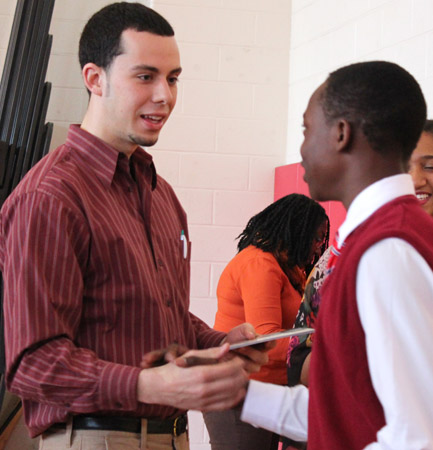 James Doss-Gollin meets students at Wilbur Cross High during the 2013 College Fair.